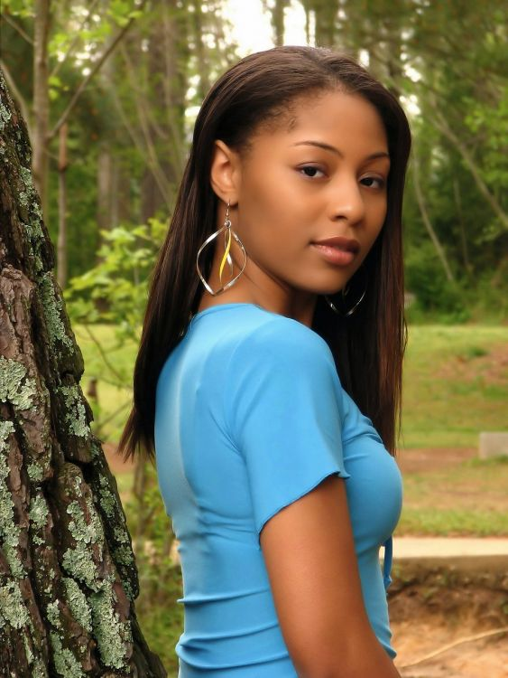 5023-a-beautiful-african-american-teen-girl-posing-against-a-tree-in-the-wood-pv.jpg